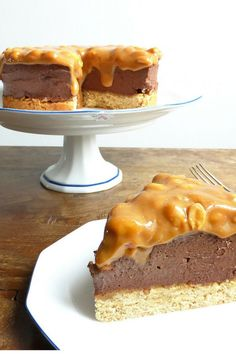 Chocolate Cheesecake with a Peanut Butter Cake Crust and Salted Peanut Dulce de Leche Topping #cheecake #recipe #foodblogger #dulcedeleche #dessert