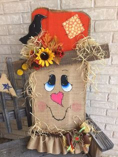Make your home stand out this season​ with a cute DIY scarecrow. Learn how to make a scarecrow and get our best scarecrow ideas, including scarecrow costumes and scarecrow crafts for preschool! Make A Scarecrow, Scarecrow Crafts, Fall Scarecrows, Scarecrow Ideas, Wood Scarecrow, Scarecrow Face, Scarecrow In The Garden, Thanksgiving Crafts, Holiday Crafts
