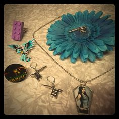 Tattoo Coffin Set All items pictured our part of this listing in for one price. 1 Kat Von D coffin necklace, 1 set of tattoo machine earrings for pierced ears, matching turquoise flower clip with tattoo machine in center, 1 Americana style tattoo blue swallow pin & 2 rings (1 is a purple Lego & the other is of Lux Interior of the Cramps). If you have any questions please message me I am online Daly. Thank you for checking out my closet! Jewelry