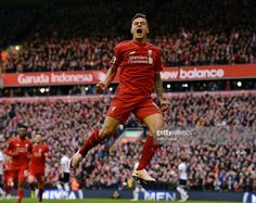 Philippe Coutinho of Liverpool celebrates after scoring a goal during the Barclays Premier League match between Liverpool and Tottenham Hotspur at Anfield on April 2, 2016 in Liverpool, England.