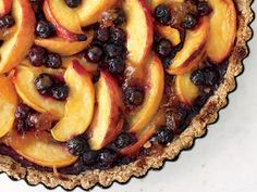 Peach and Blueberry Tart with Pecan Crust http://www.prevention.com/food/healthy-recipes/farmers-market-recipe-finder-blueberries/peach-and-blueberry-tart-with-pecan-crust