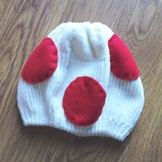 """Super Mario """"Toad"""" White Knit Beanie I made this cutie a few years ago for a Halloween costume! Soft ivory knit beanie with hand-sewn red felt polka dots. Perfect for Super Mario fans! Laid flat, measures 6 1/2"""" at the base (provides stretch), 7 3/4"""" top to bottom. Only worn once, excellent condition! Accessories Hats"""