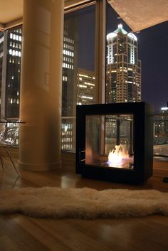 Create your own wall mounted fireplace is easy with one of our zero-clearance fireplace inserts. Browse single-sided, bay, peninsula, corner and see-through fireplace options. City Living, My Living Room, Pent House, My House, Exterior Design, Interior And Exterior, Freestanding Fireplace, Floating Fireplace, Bioethanol Fireplace