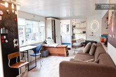 This unique flat with mid-century modern decor is actually an entire houseboat docked in one of Amsterdam's most beautiful canals.