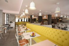 diner seating, yellow, simple condiments, white walls