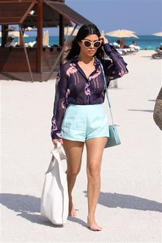 For an afternoon at the beach in Miami in March 2014, the reality star stepped out in a printed flamingo top with a pair of structured turquoise shorts and an oversized purse. That Kourtney Kardashian sure knows how to step up her beach fashion.