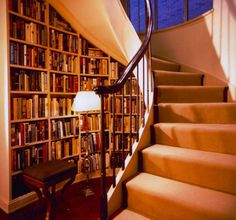 Not all homes have a vacant room ready to turn over to a library. In such cases, make your book storage evoke the feel of a traditional library, even if you cannot utilize all the elements. Have a reading seat, or stool, as close to the area as possible, to encourage reading.