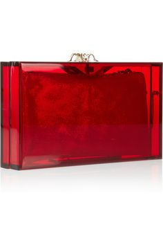 Charlotte Olympia's 'Pandora' clutch is fashion's must-have cocktail accessory. Topped with a crystal-embellished spider clasp, this Perspex piece includes a gold brushed-faux suede pouch - it's the perfect size for a phone and tube of lipstick. Carry yours to a gallery opening against a graphic cocktail dress.