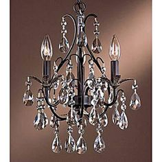@Overstock.com.com - Three-light Antique Copper Crystal Chandelier - Lend any room the allure of yesteryear with this antique-finish three-light crystal chandelier. This large chandelier is brimming with Old World charm with the grace of a bygone era and holds three 60-watt bulbs to illuminate your space.  http://www.overstock.com/Home-Garden/Three-light-Antique-Copper-Crystal-Chandelier/4406943/product.html?CID=214117 $101.69 13.5 inches wide x 19 inches high