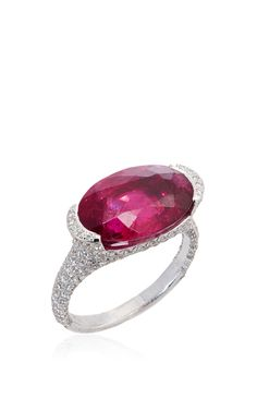 **Sidney Garber** ring is rendered in 18k white gold and showcases an oval pink tourmaline surrounded by glistening diamonds.
