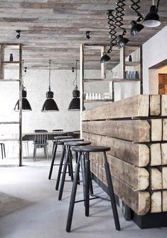 Barn wood ceiling, lights for table & bar, plus barn wood on island