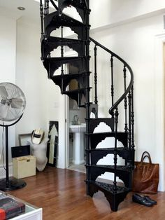 Image above: This wrought-iron spiral staircase in Toronto-based artist Courtney Wotherspoon's home weighs in at one ton and runs from the living room to the loft bedroom above.