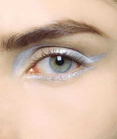 A lighter take on the dark black cat eyeliner. Silver metallic. Perfect for tonight! #eyeliner #beauty #metallic #makeup