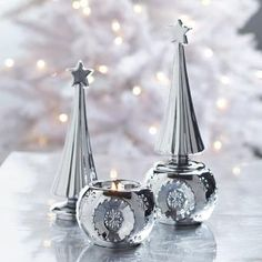 "This treetop glistens! Shimmering metallic candle holder has the look of an heirloom tree topper. Two-piece ceramic design holds a tealight, sold separately, in the base. 9¼""h, 3½""dia. By PartyLite® Candles P91360"