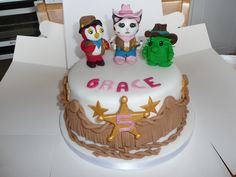 Sheriff Callie Birthday Cake. With a cowgirl themed fringe detail, Sheriff badges and the three main characters from the show 'Sheriff Callie's Wild West' on Disney Junior. The perfect centre piece for any Sheriff Callie Party.