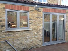 Bi-Fold Doors - bespoke solid timber, aluminium and UPVC bi-fold doors. Enfield Windows supply and fit bi-fold doors in Enfield and the north London area. Window Color, Exterior House Colors, Windows Exterior, Windows, Windows And Doors, House Extension Design, House Front, Bifold Doors, House Exterior