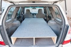 With my photo adventure to the Southwest fast approaching, I've been trying to figure out the best setup for camping in my 2007 Subaru Forrester. I did plenty of research, reading article after article about how people were camping in their car. Many people said a 6 foot person just couldn't g