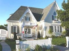 The Gothic Style cottage that follows is a modern day repro-  duction of a Victorian-era design from Victorian Cottage Plans,  based  in Sonoma, California.  Clad with board and batten siding, this authentic de-  sign  features pointed arch windows and intricate bargeboards on the up-  per story gables -- all of which are typical of the style.