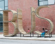 Wait for the Bus inside a Giant Typographic Sculpture in Baltimore typography public transportation furniture Baltimore architecture
