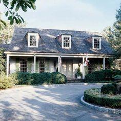 cedar-shake roof, apple green shutters, dormers  Bill Ingram
