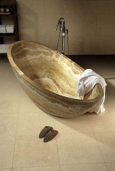 beautiful Stone bathtub     From Very Cool Photo blog         (Unfortunately stone does not retain heat)