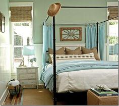 Coastal Bedroom with bamboo shades and sisal area rug