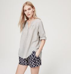 Starring a split neck (and an effortlessly drapey fit), this piece is our idea of casual pretty. Split neck. 3/4 sleeves. Shirred beneath front and back yoke. Button cuffs. Hi-lo shirttail hem.