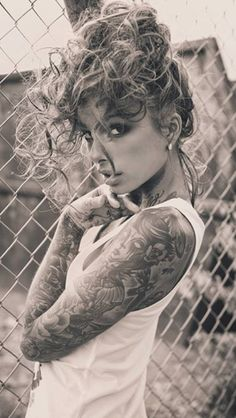 www.facebook.com/wauwpage--- great full tattoo sleeve! She's also very pretty.