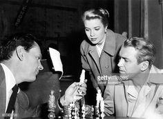Wendell Corey, Grace Kelly and James Stewart during filming of REAR WINDOW