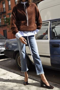 love all of it! drawstring striped shirt, wool sweater, cropped frayed jeans, block heel pumps.