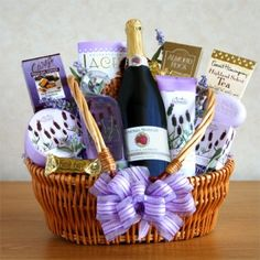 """""""Relax and Enjoy."""" On Valentine's Day show her  you care by sending a special treat!    Includes:    A Lavender shower gel  Body lotion  Luxuriating bath bar  Raspberry sparkling cider  English toffee  Almond Roca  Lacey's cookies"""