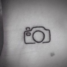 http://tattooideas247.com/tiny-camera-tattoo/ Tiny Camera Tattoo #Camera, #Linework, #Minimal, #Photography, #SLR, #Small, #Tiny, #Wrist