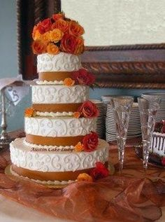 ivory frosting and golden brown/spice ribbon, and the fabulous roses were shades that ranged from orange to brown. Link to cake: http://www.picturetrail.com/sfx/album/view/5052405