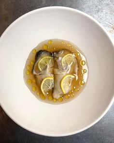 Oysters poached and marinated with whisky, cold roots consommé infused with black cardamom, coffee oil and limequat at Septime, Paris Restaurant Bon, Paris Restaurants, Menu, Oysters, Whisky, Punch Bowls, Roots, Cold, Whiskey