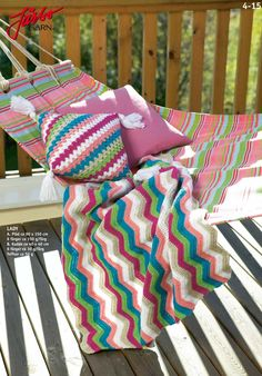 Crochet foot blanket with matching pillow.