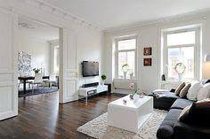 bright, dark floors, white room: even the tv works, here. styling by alvhem via pinmarklet