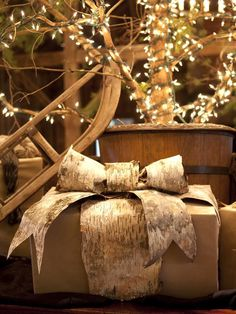 This gift is tied beautifully with birch bark ribbon, available at craft stores. >> http://www.diynetwork.com/decorating/how-to-create-a-rustic-christmas-look/pictures/index.html?soc=pinterest
