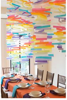 Sew some colorful, modern mobiles made of vellum paper to hang above your table or around your room.