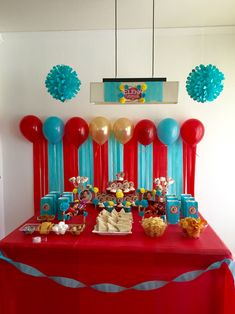 Elena of avalor party theme - Love the simplicity and matching theme colors of blue, red, gold decorations.