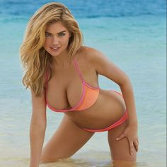 Kate in Bikini leans over and shows cleavage