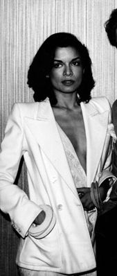Power suit, deep plunge, small boobs, & lots o' 'tude | Bianca Jagger