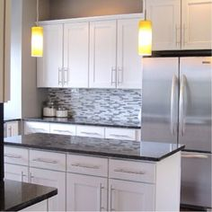 Love the cupboards and back splash