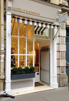 Aurelie Bidermann, Paris - love the tiny boxwoods in the window box + striped awning