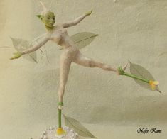 Malgan, a little green ice's pixie; walking in the snow with her flower stilts. By Nefer Kane