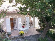 a Glass of Wine in the Shade of a Tall Fig Tree Aix-En-Provence house rental - View of Front Terrace Aix En Provence, Provence France, Berlin, Holiday Accommodation, European Travel, Rental Apartments, Renting A House, Country Decor, Ideal Home