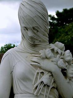 Cemeteries Ghosts Graveyards Spirits: Veiled marble cemetery statue.