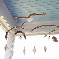 Beach Mobiles Driftwood, shells, and string are all you need for a beach-inspired mobile. Drill small holes through driftwood. Thread string through and tie a knot at one end. On the other end, tie shells. Hang from the ceiling to enjoy the beach scene every day.