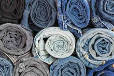 Closeup rolled of blue jeans pants, dark blue denim trousers Blue Denim, Blue Jeans, Jeans Pants, Trousers, Reusable Bags, Packing Tips, Dark Blue, Throw Pillows, Closet