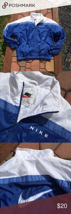 Nike Youth Boys Windbreaker Jacket Size Large Size Youth large 12/14. Super gently preowned. Be sure to view the other items in our closet. We offer  women's, Mens and kids items in a variety of sizes. Bundle and save!! We love reasonable offers!! Thank you for viewing our item!! Nike Jackets & Coats