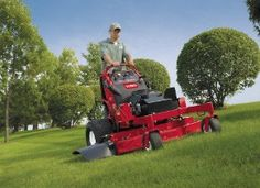 The Toro GrandStandTM stand-on mower offers a cross between the Mid-Size walk-behinds and the ride-on zero-turn mowers.